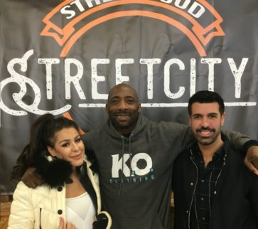 Cherise Hatfield, Johnny Nelson & Dan Hatfield with the Street City Market sign
